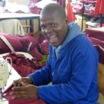 Nqaba Nombewu Working On Casual Day 2016 T-shirt Production Line